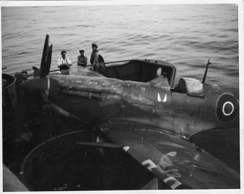 "Sporting invasion stripes Hellcat JV125 'E-N' of 800 NAS ranged on JHMS Emperor's flight deck preparing for take off during operation ""Dragoon"", August 1944."
