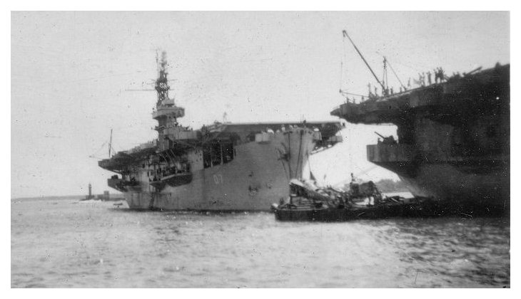 HMS Patroller moored behind HMS Queen in Colombo harbour March 31st 1946; Queen is embarking surplus airframes for disposal at sea while Patroller is loading stores and passengers ready for the next leg of her trooping voyage.  Photo: courtesy of Mrs. Kay Morgan, Thanks to David Weaver for photo interpretation.