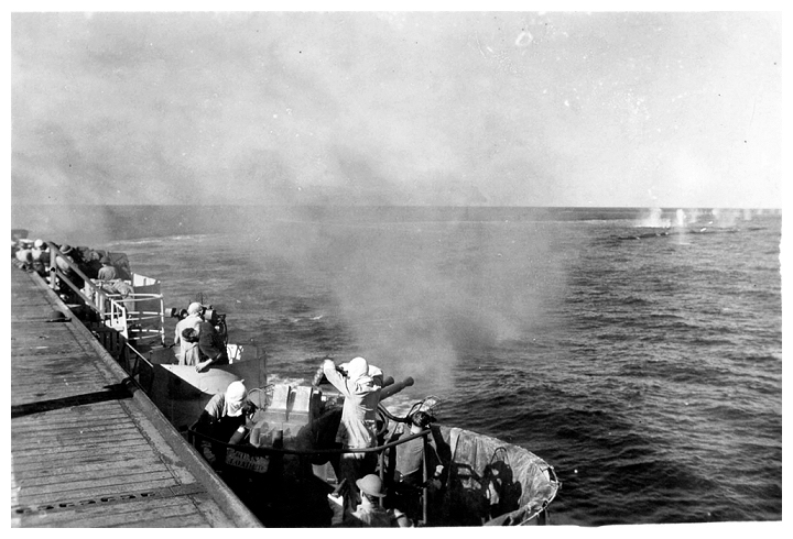 Starboard aft 40mm Bofors crew test fire their weapons during gunnery exercises in the Straits of Georgia, April 1944