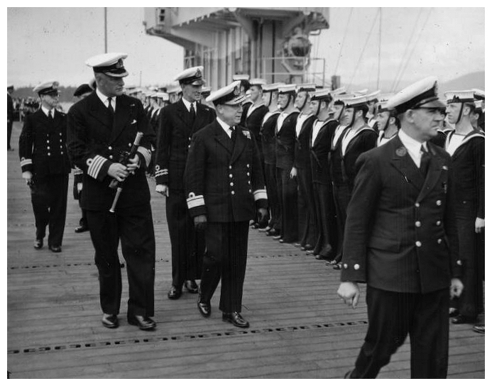 Rear Admiral V. G. Brodeur RCN & Senior Royal Navy Officers inspect the ships company after the Dedication Service aboard HMS Thane, Vancouver, June 44.[Photo: Ray Keena]