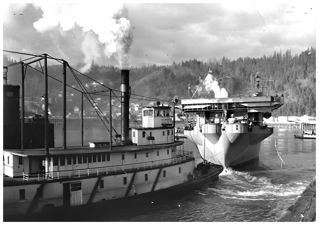 HMS Tracker manoeuvres in the Willamette River with the aid of a river tug, before beginning acceptance trials in the Colombia River in early February 1943