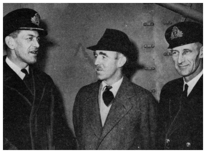 Taking over command of HMS Tracker, Commander G.C. Dickins RN poses with Mr. James McDonald, British Consul in Portland, and Lieutenant Commander S.K. Horn RN aboard Tracker.